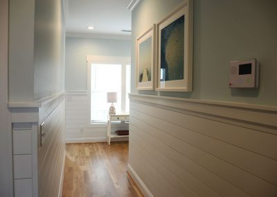Hallway transition with clapboard wainscotting
