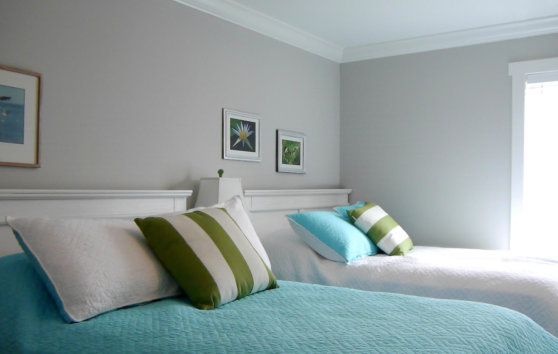 A guest room designed for two full size beds, great for rental homes as well as spill-over guest in any beach home.