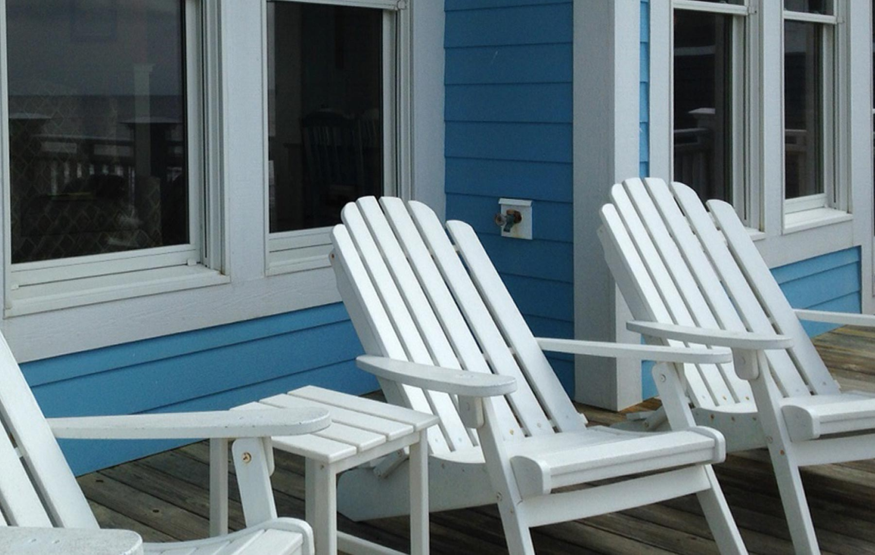 Water faucets and electrical outlets on outside porches on each floor add convenience to coastal life.